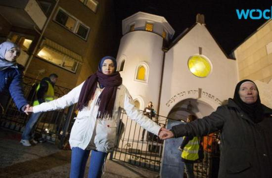 More than 1000 Norwegian Muslims form a 'Ring of Peace' around an Oslo synagogue after the terrorist attacks in Copenhagen and Paris.
