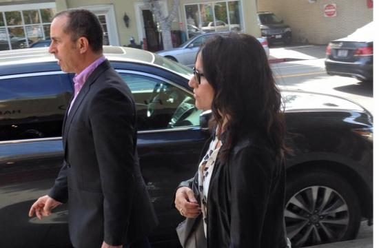 """Jerry Seinfeld and Julia Louis-Dreyfus as they walked past Platino at 909 Montana Ave. Tuesday morning while filming an episode of """"Comedians In Cars Getting Coffee."""""""