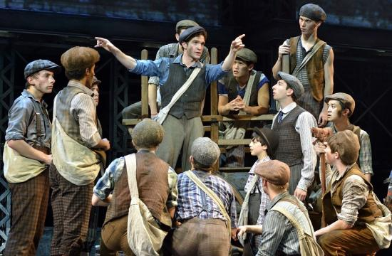 "Nico Jesus (to the right of ""Jack Kelly"" leaning on the wagon) stars in ""Newsies""."