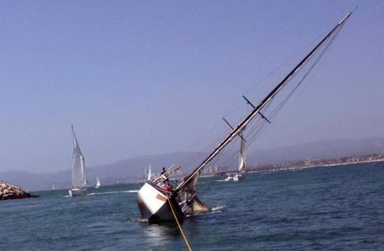 A 45-foot sailboat was knocked on its side in Venice on Sunday and had its keel broken because of heavy winds.