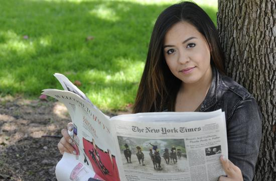 Santa Monica College student Jochebed (Jo) Smith holds a copy of the New York Times with her essay 'Swearing Off the Modern Man