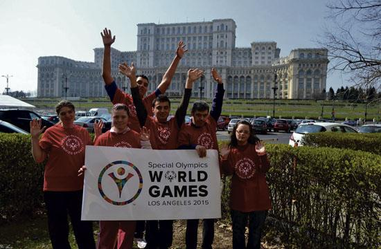 Several of the Romania Olympic World Games members striking their pose in front of the Romanian Parliament building. They will spend time in Santa Monica before the Special Olympics begin in Los Angeles on July 25.