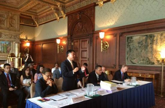 Congressman Ted Lieu (standing) and Congresswoman Karen Bass (left) convened a meeting Wednesday in Washington