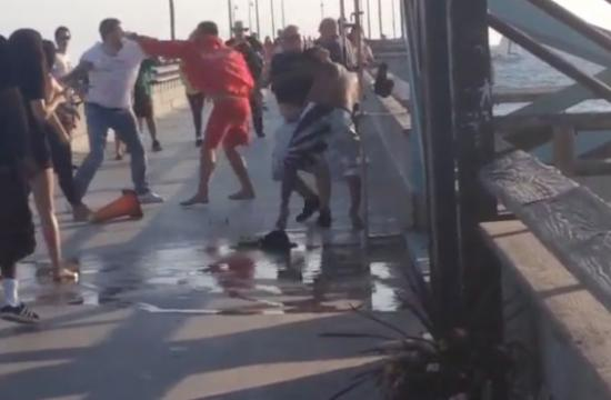 Three people were taken into custody today after a lifeguard was attacked at Venice Beach.