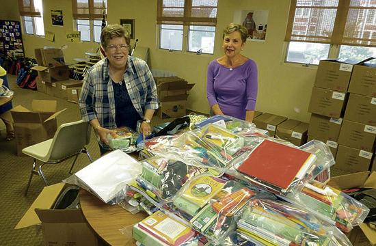 Assistance League of Santa Monica members packed backpacks on Wednesday that will be given to local students.
