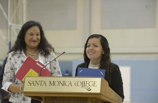 Santa Monica College student Marie Medina (right) speaks at a campus event. Medina benefitted from the strong academic support of SMC's Latino Center and Adelante Program