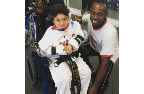 Tae Kwon Do Master Victor King with one of the Special Olympics athletes he hosted at PK Wellness.