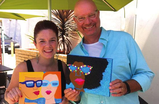 Director of Visual Arts Bobbie Rich (left) and Resonate LA Lead Pastor David Cobia with Summer of Soul Paintings.