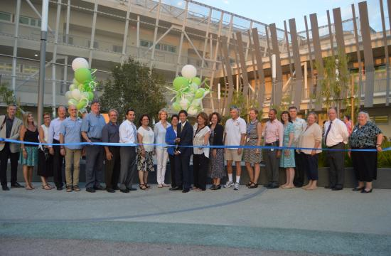 Santa Monica High School ASB President Dean Chien with the giant scissors for the ceremonial ribbon