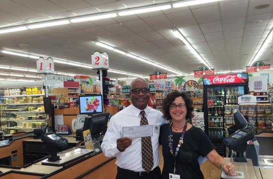 Bob's Market store supervisor Lafayette James and Westside Family Health Center development director Celia Bernstein.