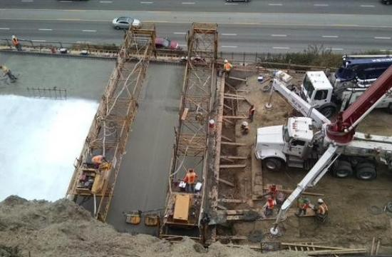 The bridge deck concrete pour portion was finished Friday ahead of the rainy season.