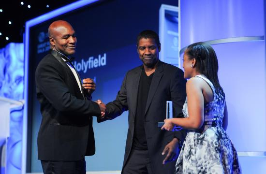 Denzel Washington (center) and BGCA National Youth of the Year Whitney Stewart (right) presented the Champion of Youth Award to Evander Holyfield (left).