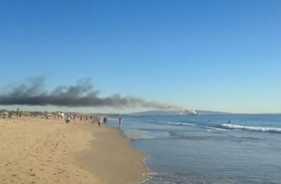 Los Angeles County Fire Department lifeguards rescued six people from a sailboat that was fully engulfed in flames off Venice Beach on Saturday.