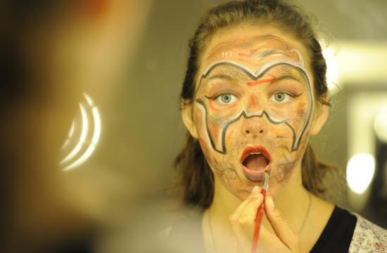 SMC Technical Theatre student Akua Parker translates artwork on to her face in a stage makeup class.