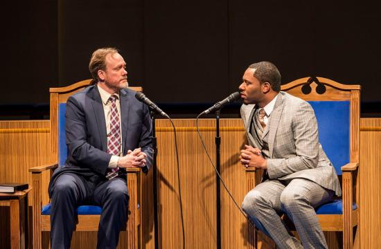 Pastor Paul (Andrew Garman) listens as associate pastor Joshua (Larry Powell) challenges his new ideas.