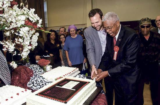 Senator Ben Allen and coalition founder Nathaniel Trives cut the Coalition's 30th Anniversary cake.