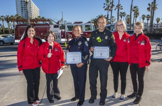 Tammy Rusznak, Debbie Morgan, Tina Vanderhorst, Stephanie McMackin pictured presenting certificates of appreciation to Santa Monica Police Chief Seabrooks and Santa Monica Fire Chief Evaro.