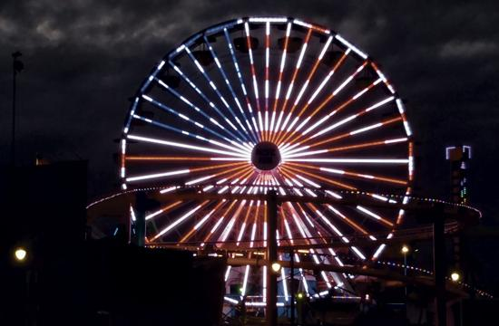 """Pacific Park is currently featuring an alternating American and rainbow waving flags light display to mark the Orlando massacre, in """"reverence to Orlando LGBT community and families,"""" according to the park. The homage began Sunday, June 12, and also displays red, white and blue, and rainbow colors, patterns and transitions."""