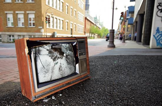 Our TV Past Out on the Sidewalk