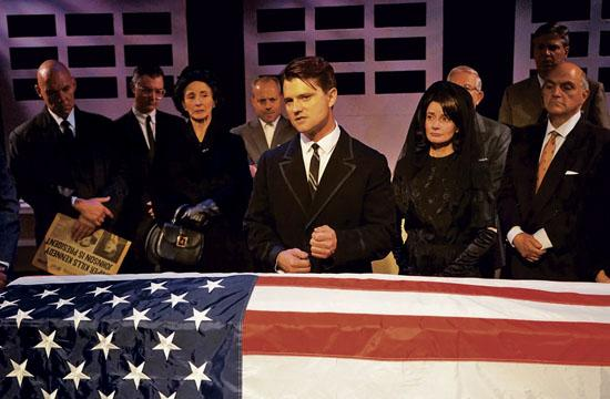 "Surrounded by JFK's ""trusted"" advisers, and JFK'S widow ((Casey McKinnon) Bobby Kennedy (Chad Brannon) delivers his potent eulogy."